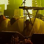 The three female members of the band Stealing Sheep in Sumo suits